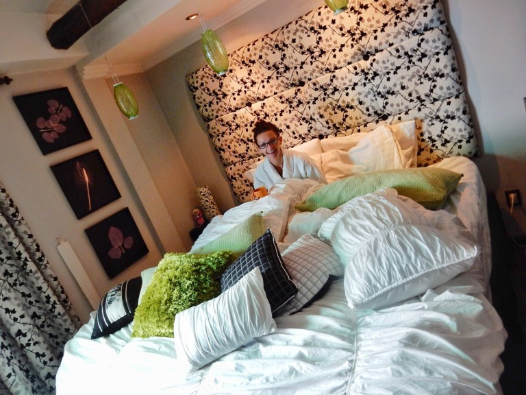 Comfy bed with tons of pillows Kashlee Parmiter