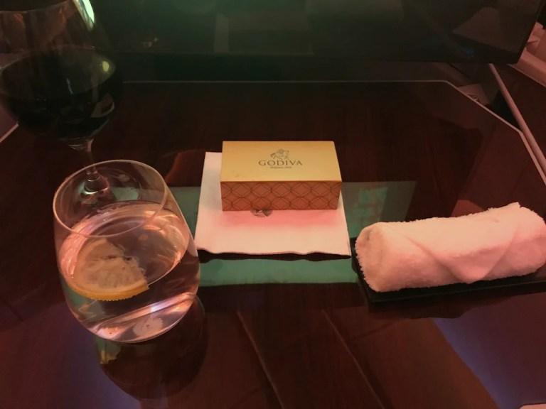 Qatar Airways with Godiva chocolates and red wine