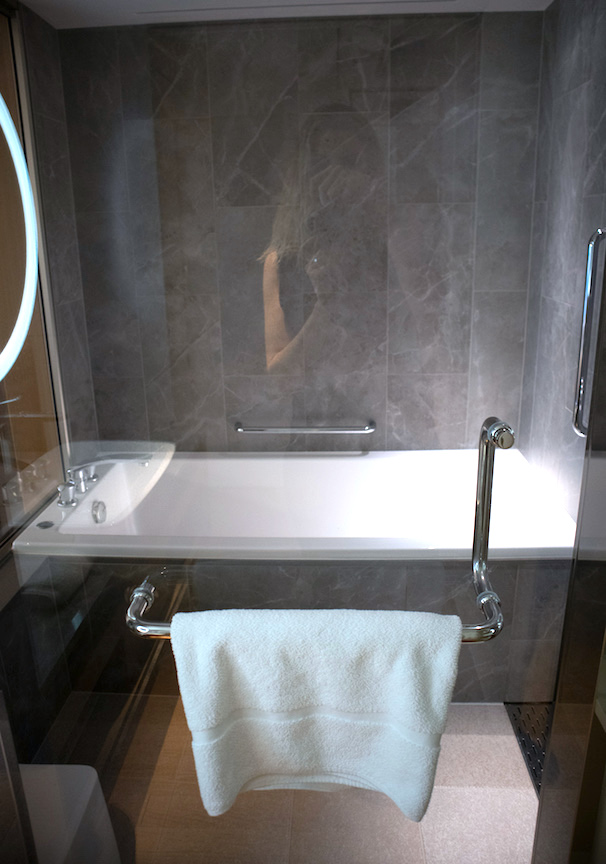 Tub and shower in bathroom of keio plaza hotel premier room