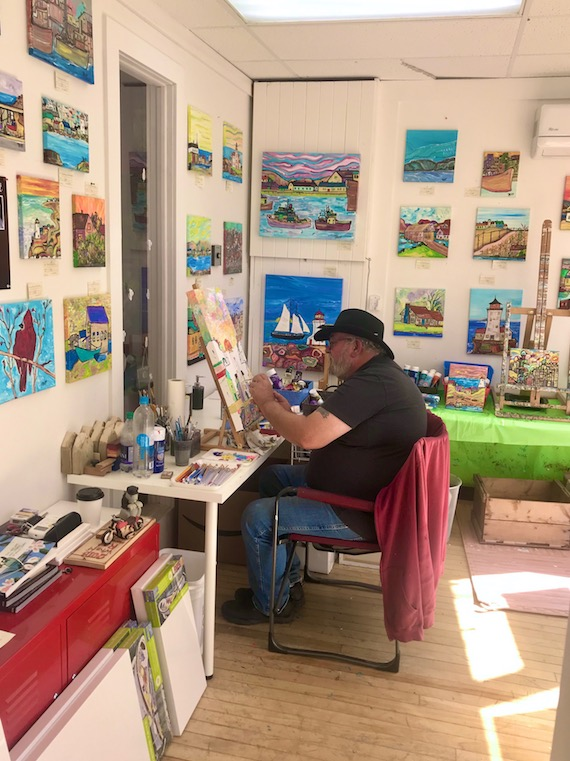 Tripp (ed parmiter) painting in his gallery