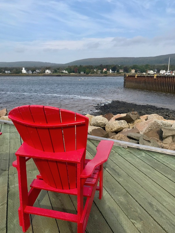 Red chair on boardwalk
