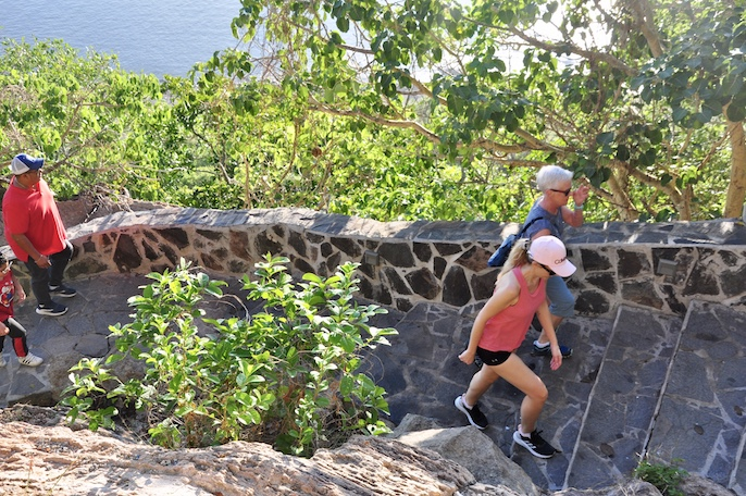 hiking up the stairs of el faro