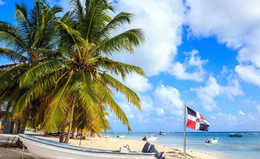 Dominican Republic beach with national flag