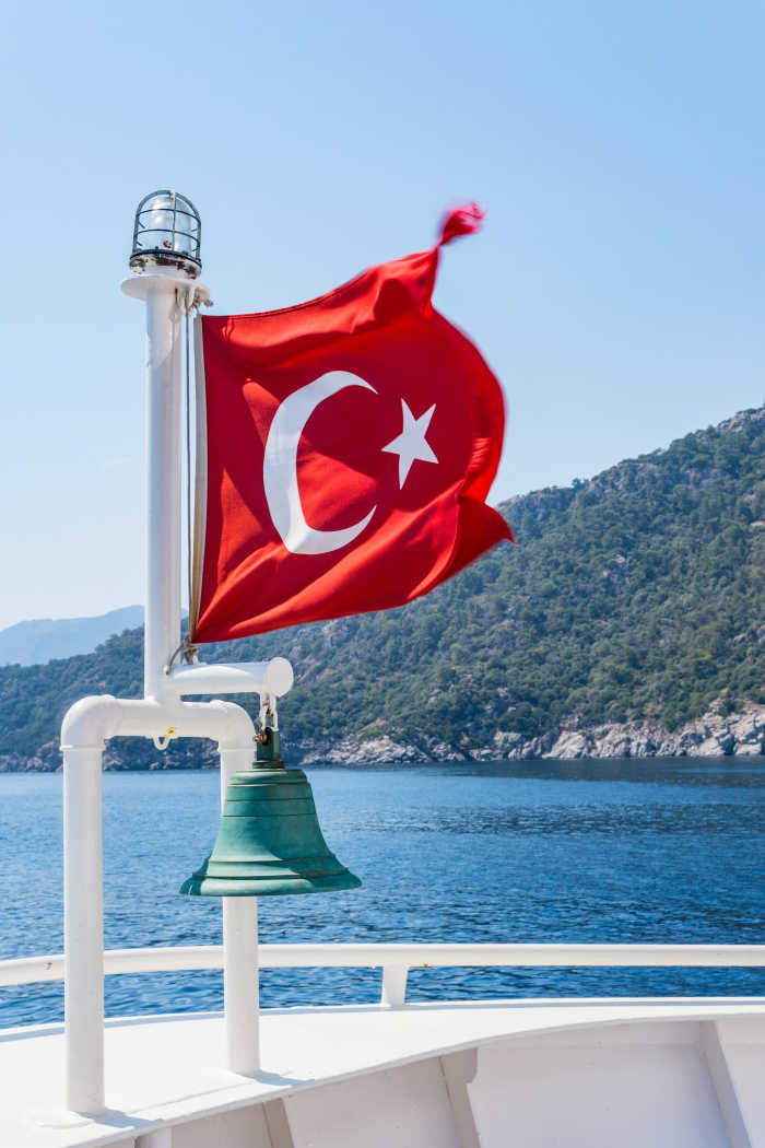 TUrkey flag on back of boat in ocean