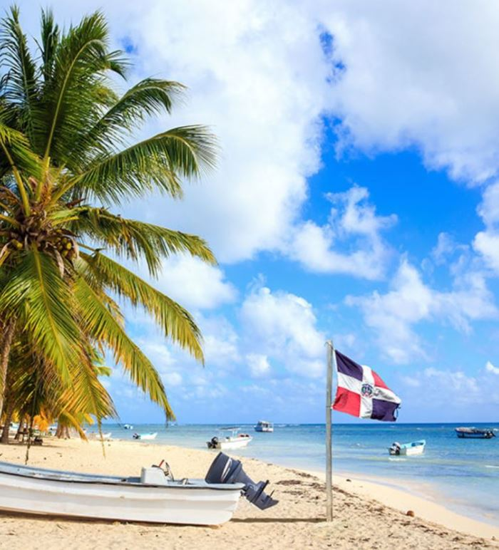 Dominican republic beach with flag