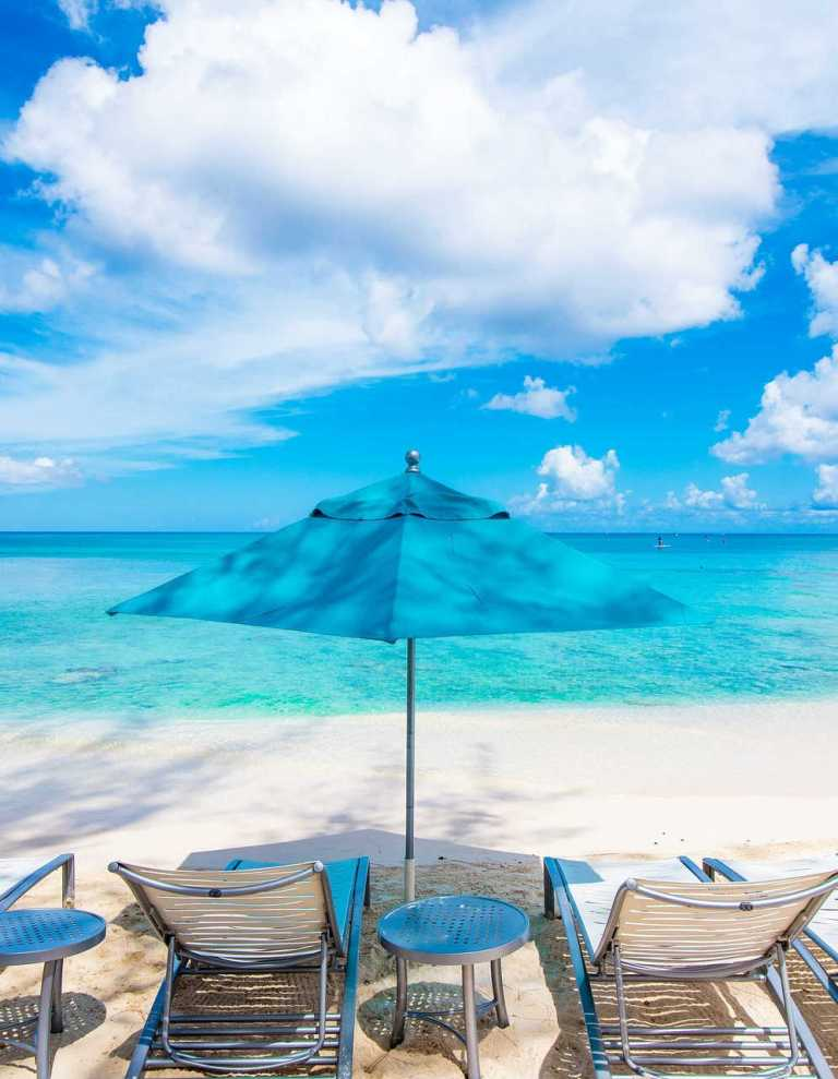 cayman islands beach with chairs