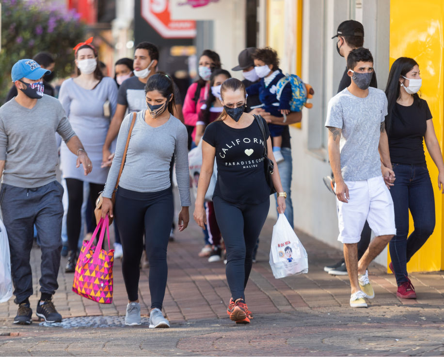 People wearing a protective mask on the streets of Apucarana, Brazil