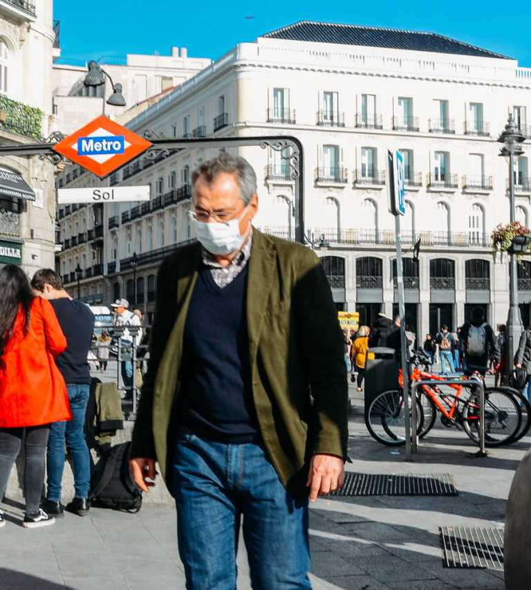 traveler wearing face mask in madrid spain