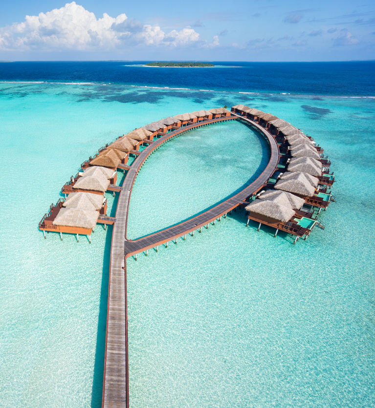 Aerial view of luxury overwater villas in the Maldives