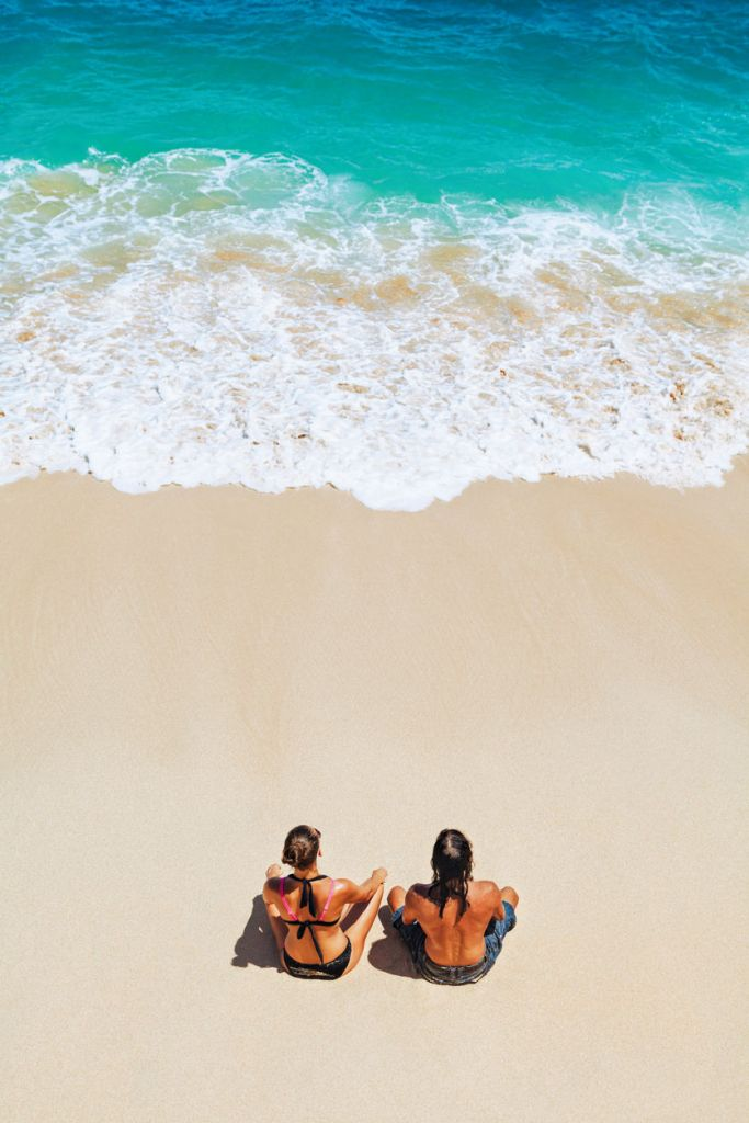 Couple relaxing on the beach in the Bahamas