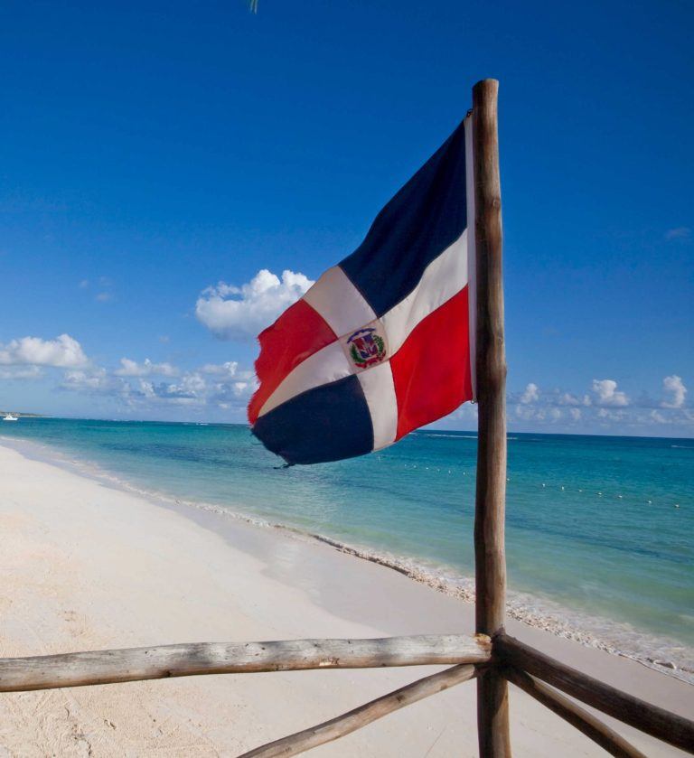 Dominican Republic flag on beach