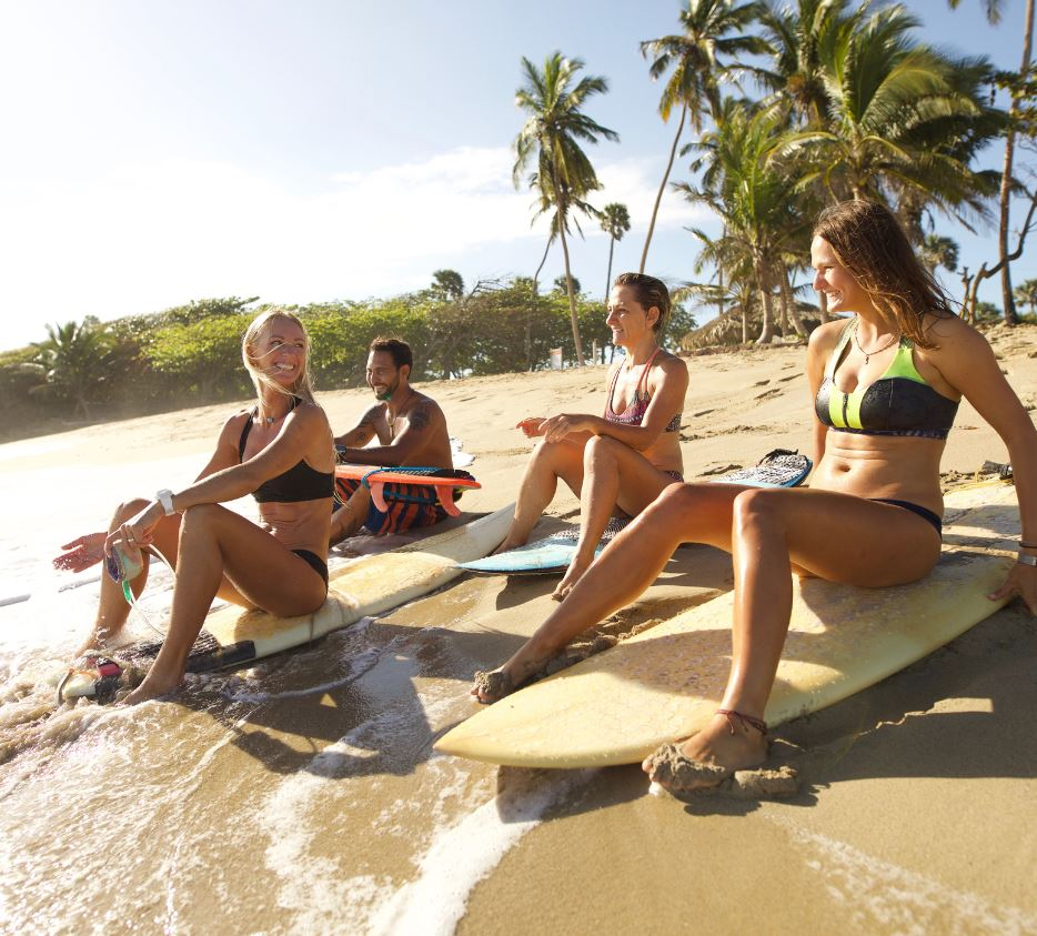 group of travelers with surf boards dominican republic
