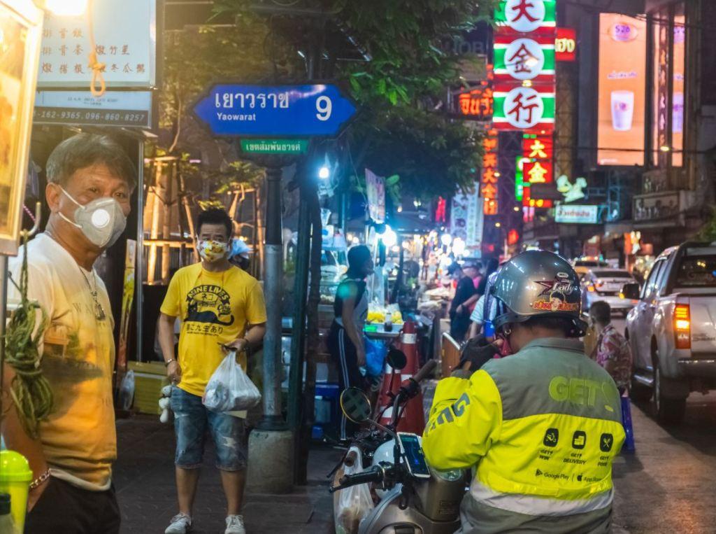 locals wearing masks in thailand