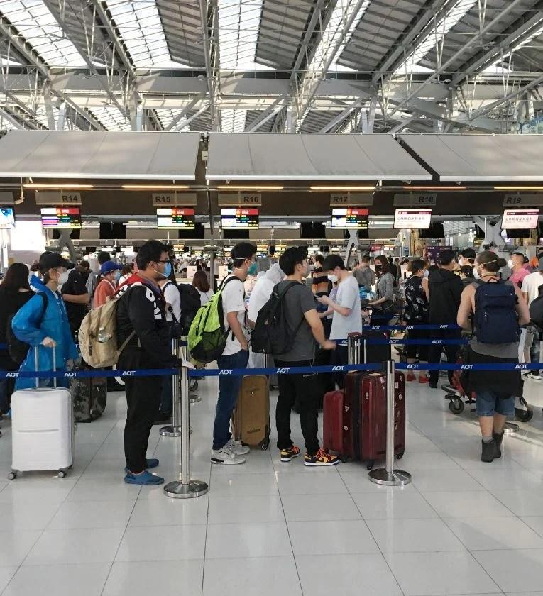passengers wear masks at bangkok airport