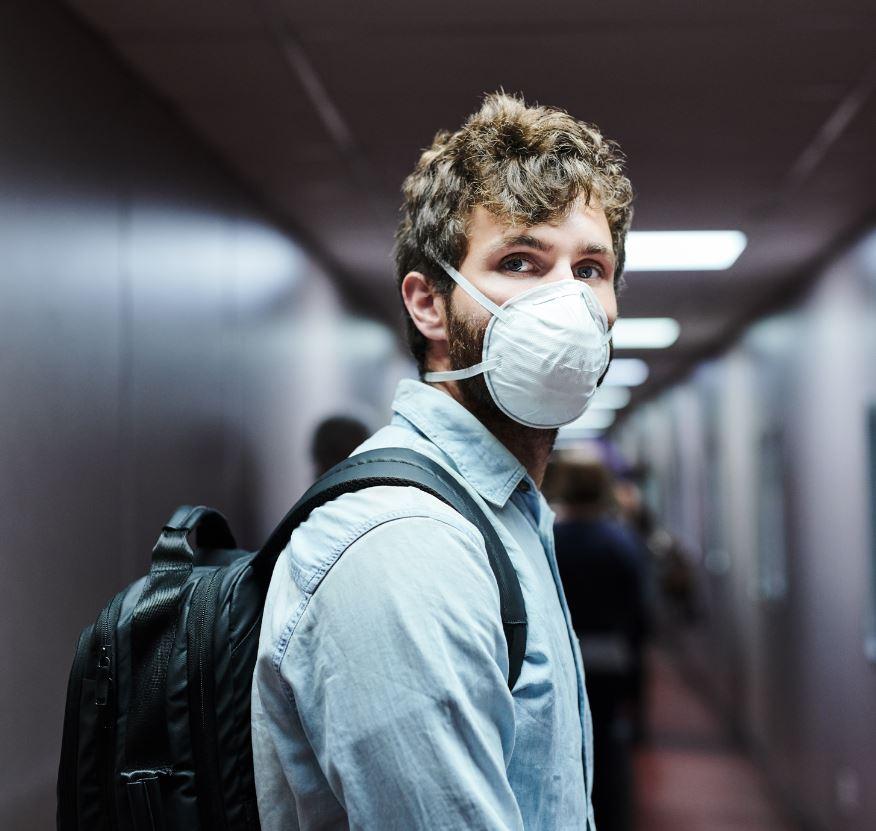 traveler wearing mask in airport
