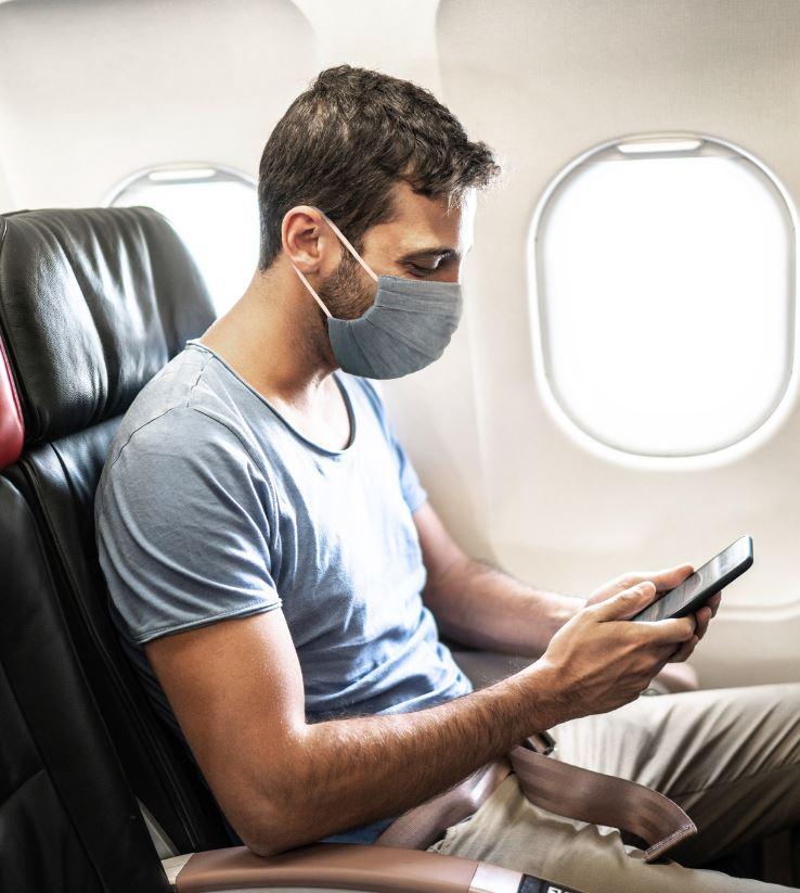 traveler wearing mask