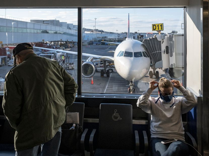 Travelers in masks waiting at US Airport