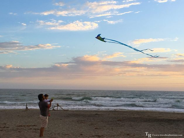 Travel Realizations, Moss Landing State Beach, California, Family Travel, A perfect family evening, baby with a kite on a seashore