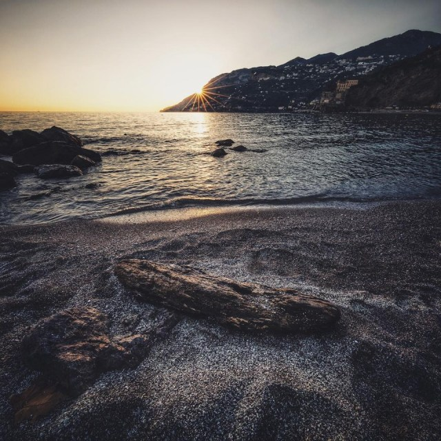 Such a relaxing feeling sitting on this beach in #Minori #Italy as the sound of waves gentle break onto the sand and the sun starts to set as it disappeared behind the hill. Life doesn't get much better than this. #SeizeTheSun