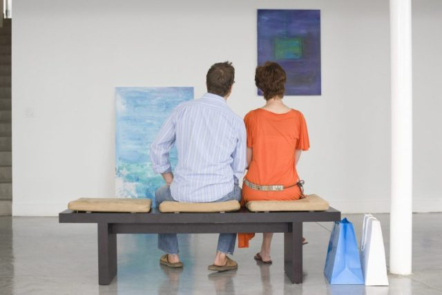 couple looking at art in gallery