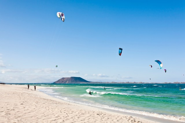 """""""Corralejo, Fuerteventura - May 29, 2012: Kite surfing in Fuerteventura. The image was taking on Corralejo beach, a perfect place for surfers. Everyday this part of the island is covered by strong wind."""""""