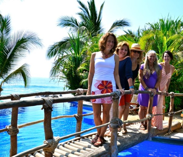 Five women standing on a bridge-save money and space when packing