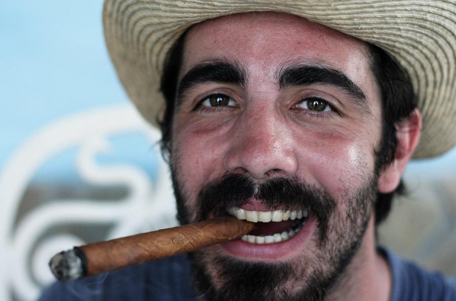 smoking cuban cigar