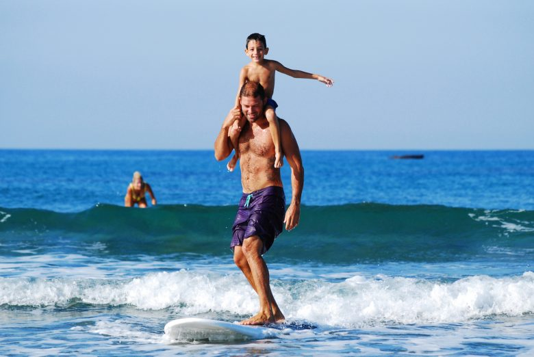 dad-and-son-surfing