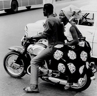 A man and a lady on a motorcycle in Lagos Nigeria (1969)