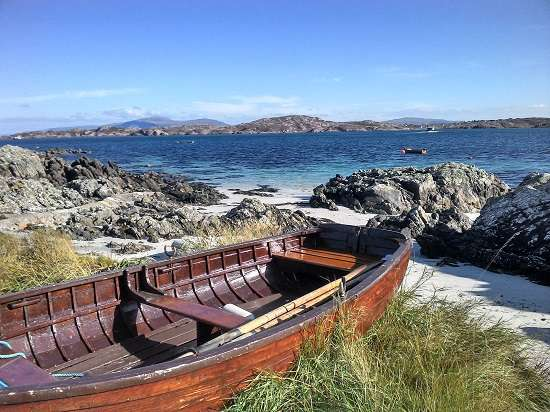 visit iona boat by the shore.