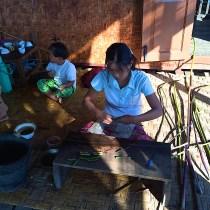 Burmese Women Stripping Lotus Stems on Inle Lake, Myanmar