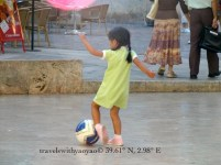 Yao Yao Playing Soccer in Soller Square