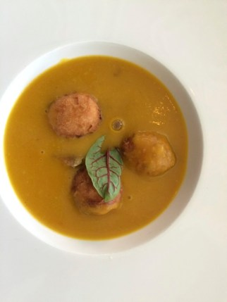 kabocha squash soup with apple fritters,
