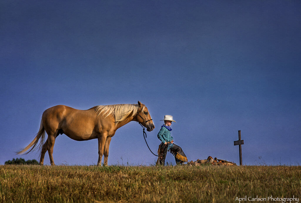 Horse Photography Workshop: Boy and horse pray at grave
