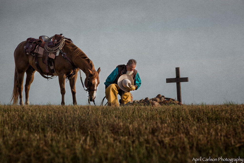 Horse Photography Workshop: Man and horse pray at grave
