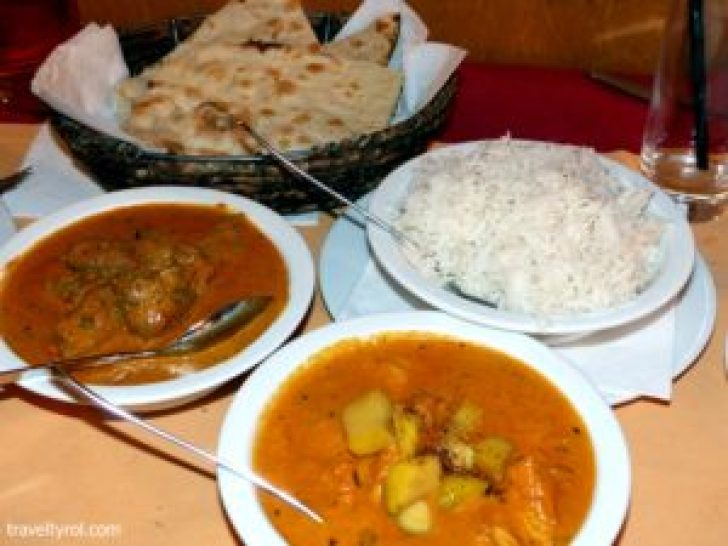 Dishes served with rice and naan bread at Himal, one of the best Innsbruck Restaurants.