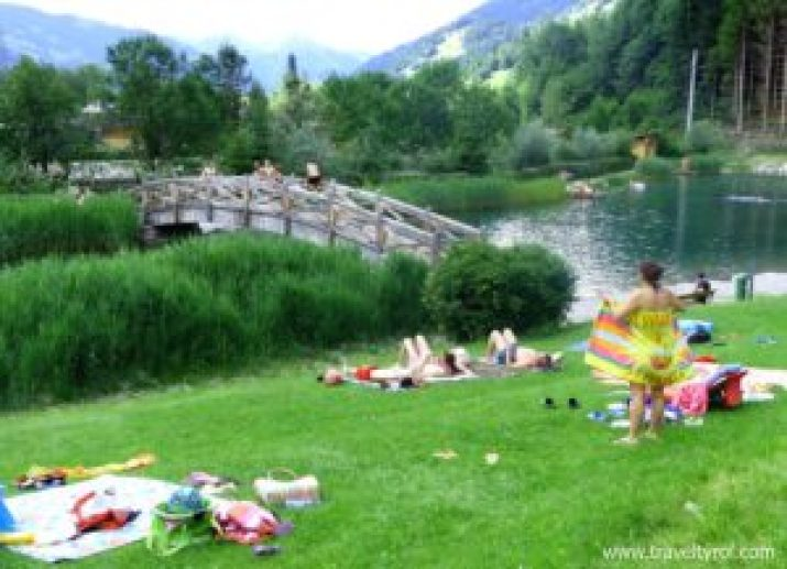 Swimming lake Camping Aufenfeld in the Zillertal, Austria.