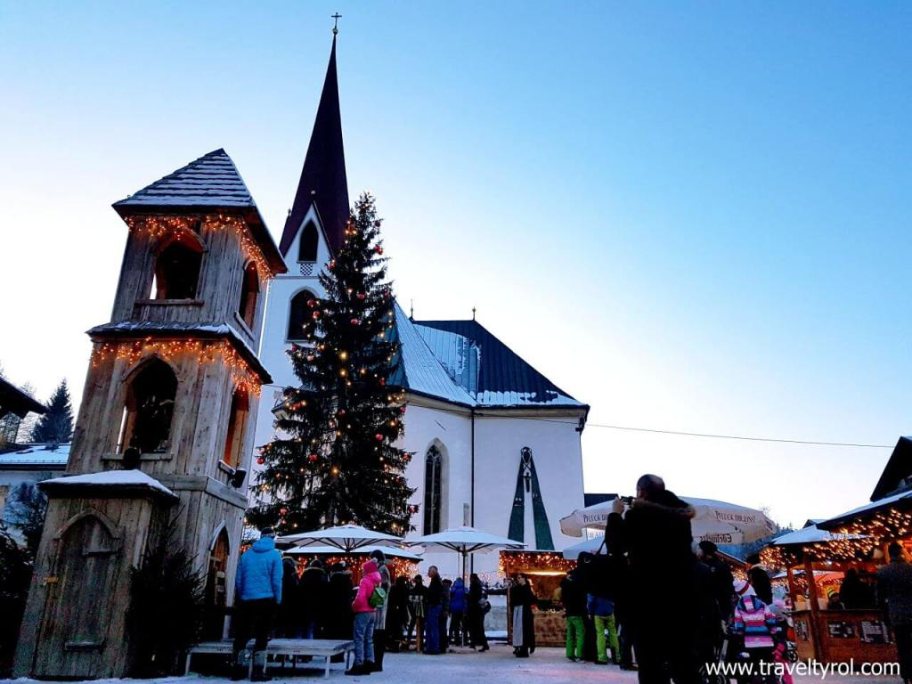 Christmas market on square next to church in Seefeld, Austria.