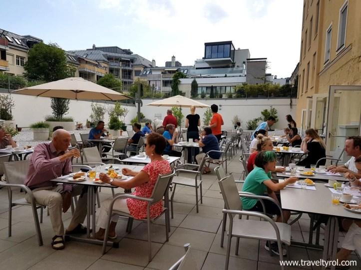 Breakfast in the courtyard of Altstadt Hotel Hofwirt Salzburg.