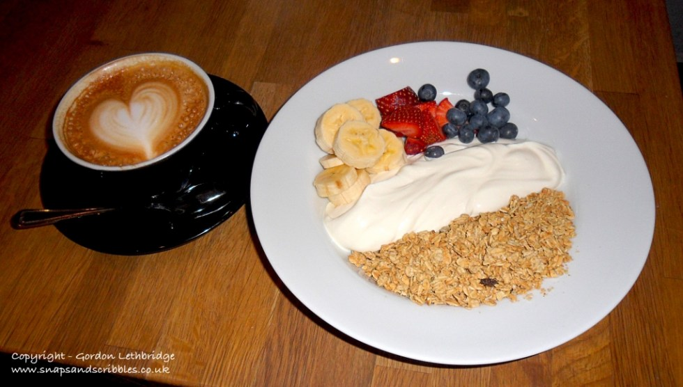 The breakfast of coffee and fruit granola at Grind Coffee Bar
