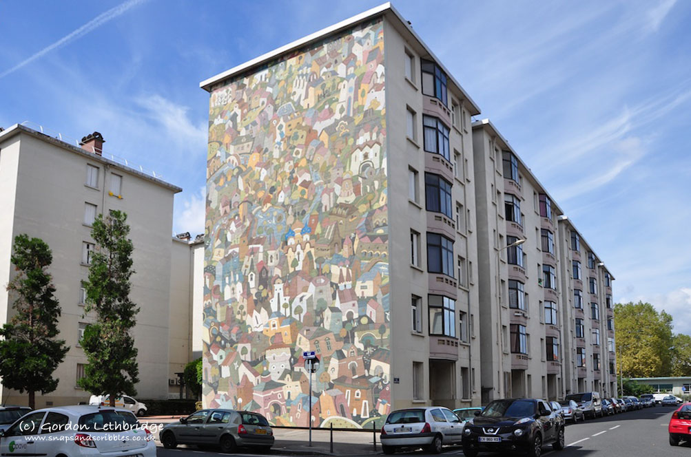 Murals celebrating the work of the architect Tony Garnier on the end of urban apartments he designed