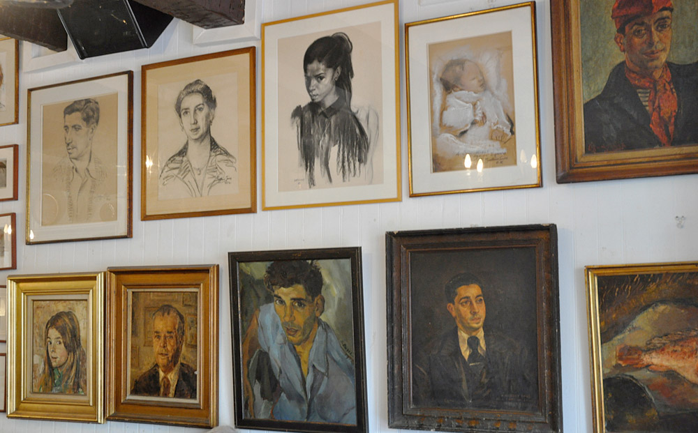 Some of the original paintings displayed in the Cafe des Templiers in Collioure