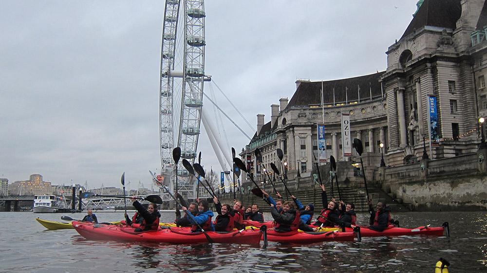 Kayaking UK, kayakers on the River Thames close to the London Eye