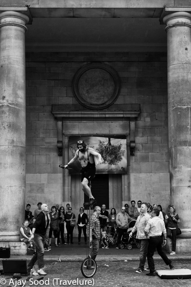 A Unicyclist performs at Covent Garden