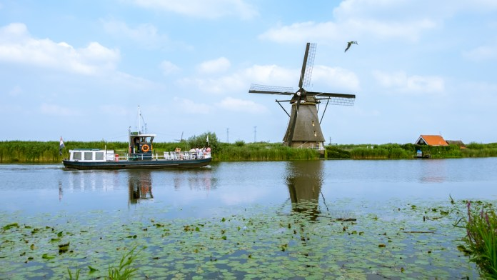 A canal hopper takes the visitors for a tour of Windmills of Kinderdijk