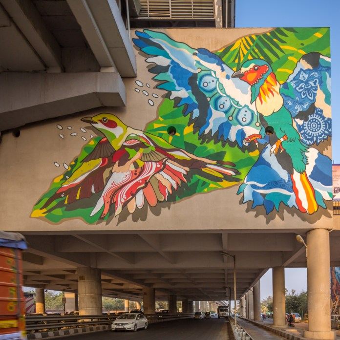 Colourful drawings of kingfisher and mynah birds juxtapose nature on this urban landscape - The City Is Their Canvas