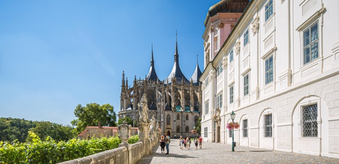 The bright reds, sparkling greens, hues of blues, and rich purples impart the stained glass windows, exquisite vibrance. - St Barbara Church, Kutna Hora - Central Europe's Architectural Beacon - Travelure ©