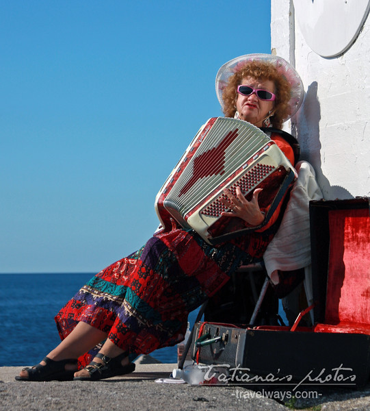 Accordion Player Lady at Peggy's Cove Lighthouse