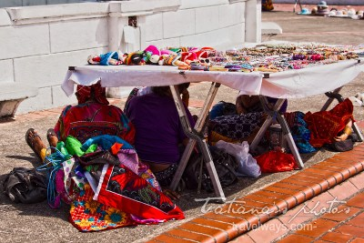 Kuna vendors hiding from the sun in Casco Viejo, Panama