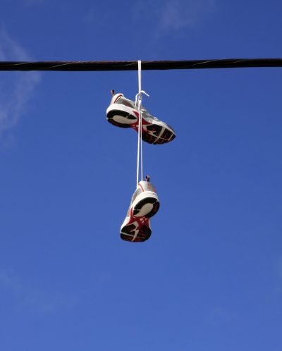 Discarded shoes hanging on a power line